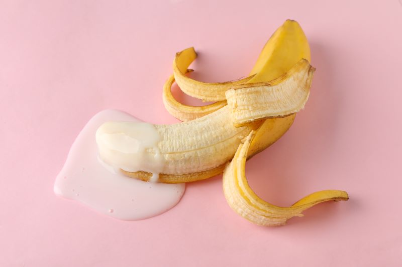 Banana with liquid showing ejaculation concept