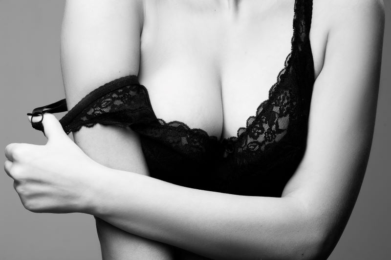 Close up of woman's breasts in lace top