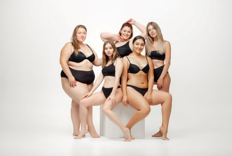 Group of diverse women posing in lingerie
