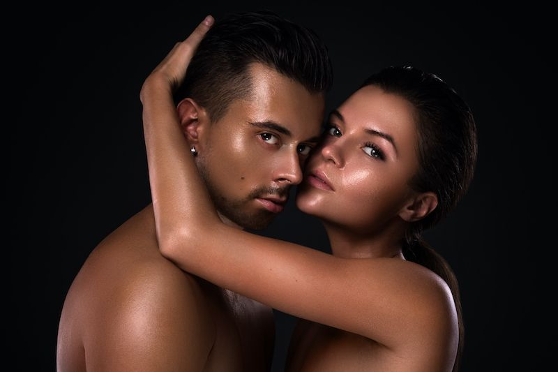 Attractive couple naked embracing