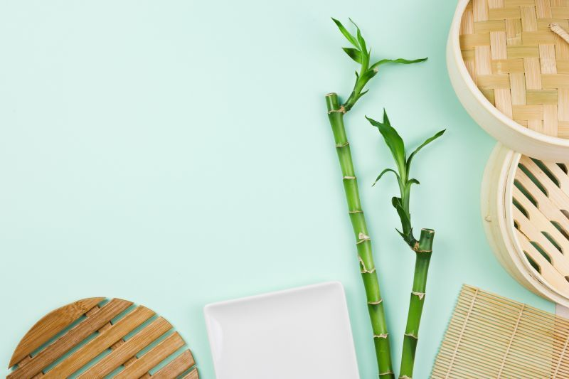 Bamboo sticks and other bamboo products on table