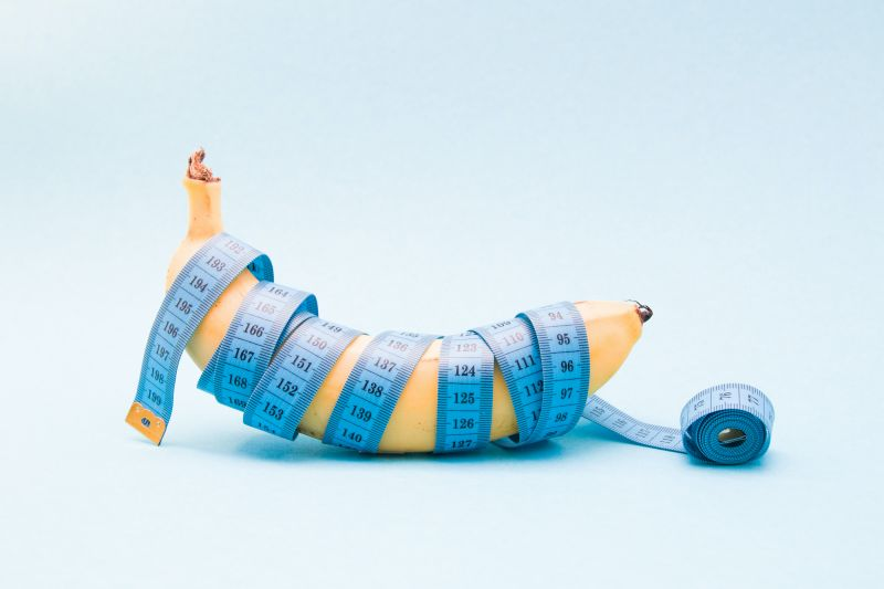 Banana wrapped in blue measuring tape