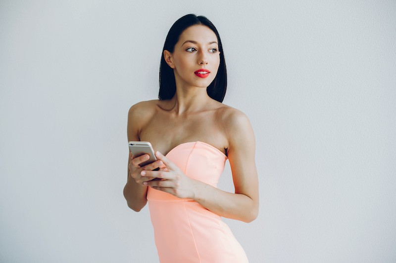 sexy woman holding a mobile phone