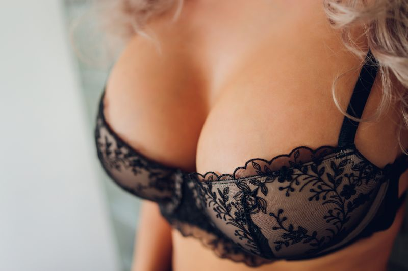 Close up of breasts in black lace bra