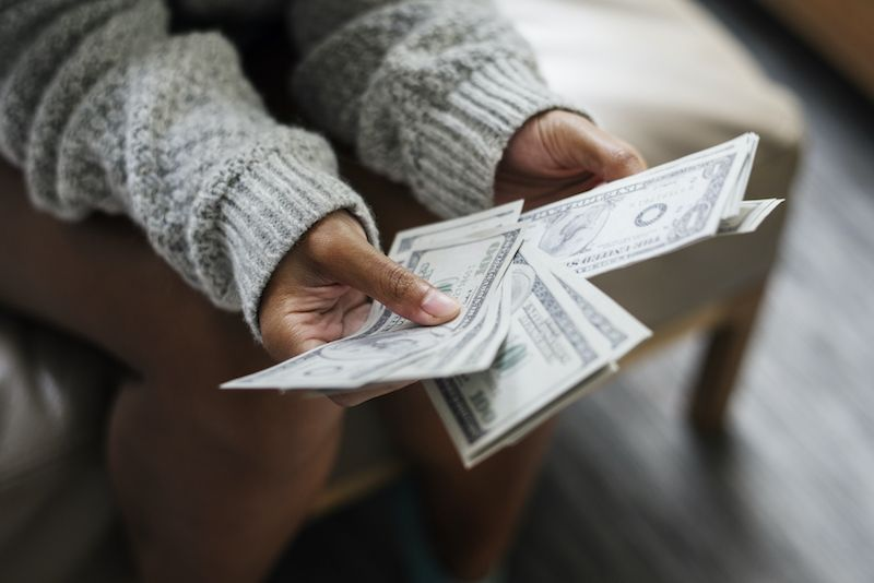 Close up of woman counting money