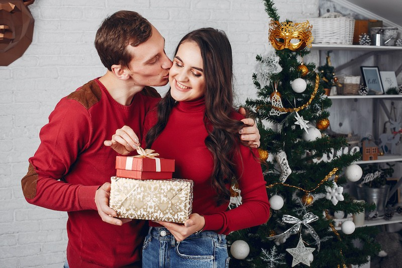 Couple celebrating naughty Christmas