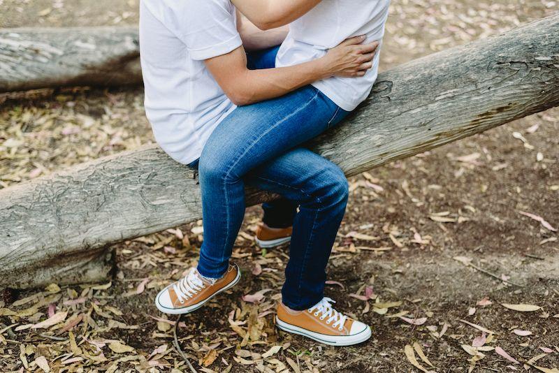 Couple cross legged outdoors