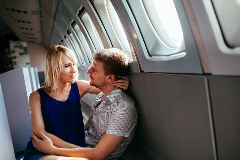 Couple embracing on plane