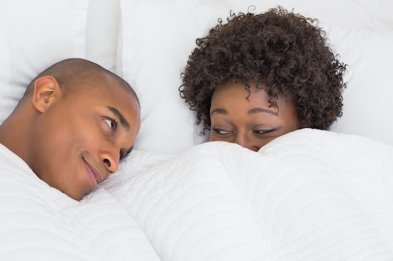 Couple in bed flirty and romantic