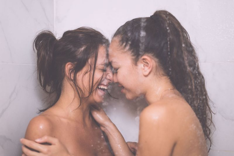 Couple laughing in shower together