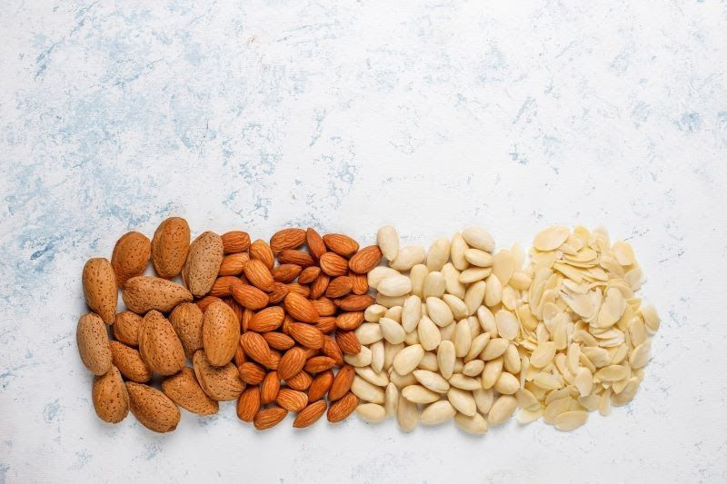 Different types of almonds on a table