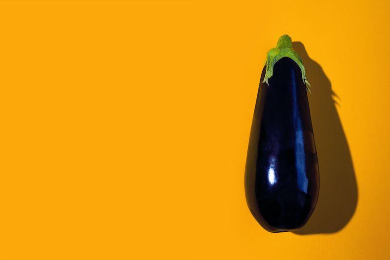 Eggplant on yellow background
