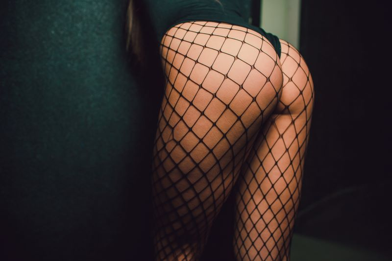 Woman's butt and legs in fishnets