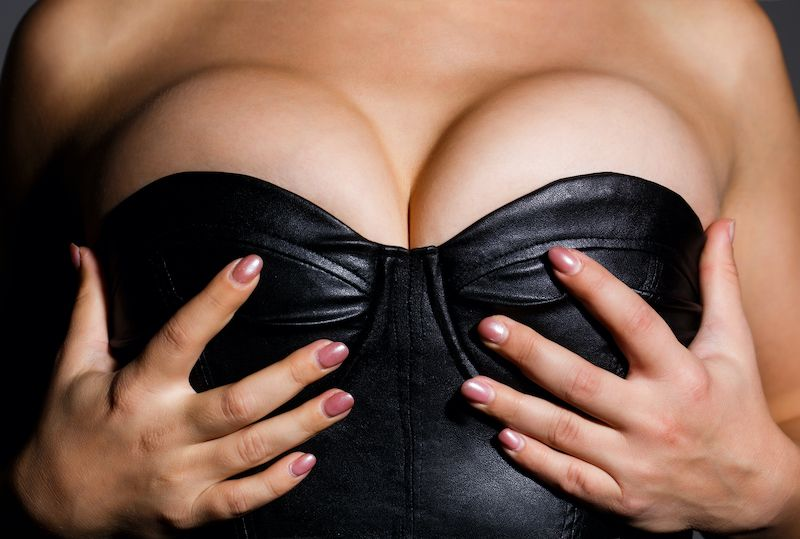 Female chest in leather top