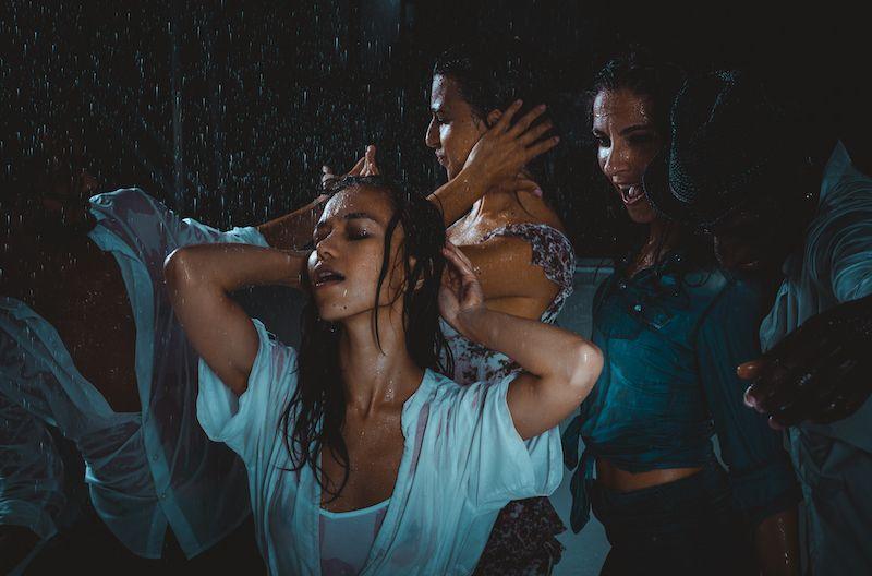 Friends dancing in the rain