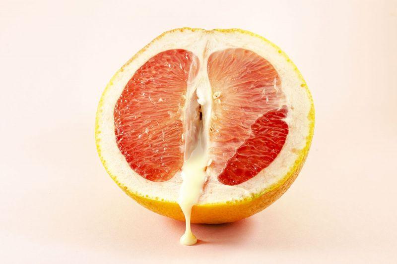 Grapefruit with liquid showing orgasm concept