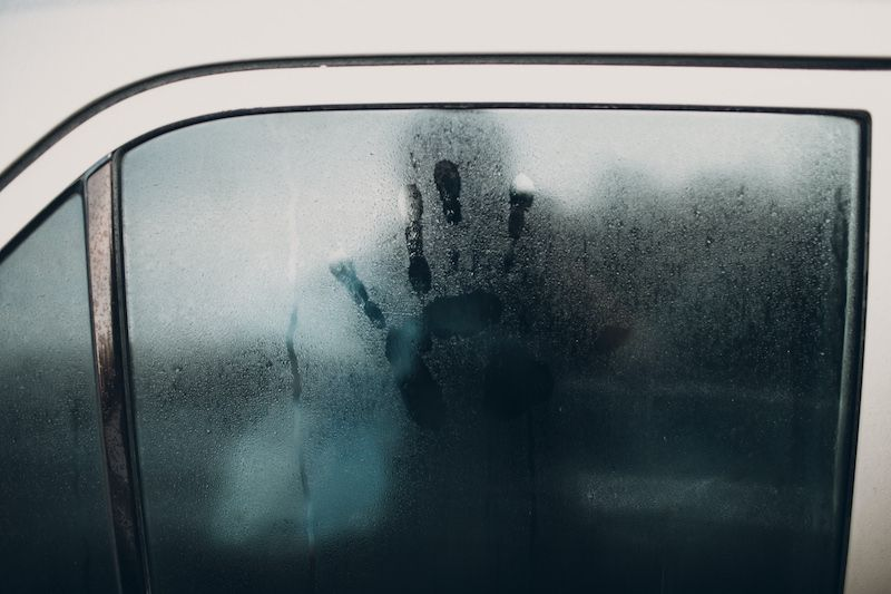 Handprint on a steamy car window