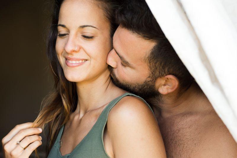 Happy couple neck kissing