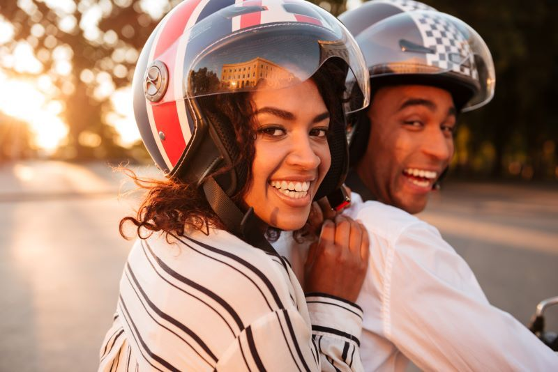 Happy couple on motorbike