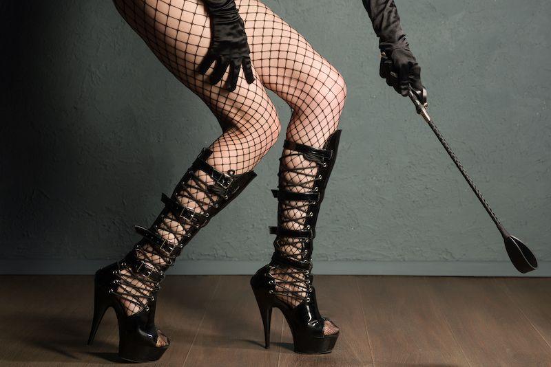 Female legs with bondage gear
