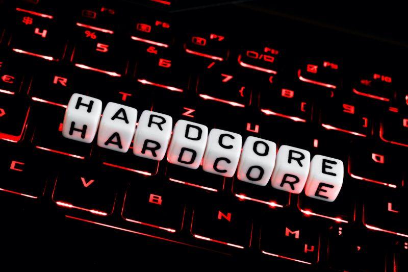 Lettering spelling out hardcore on dark keyboard
