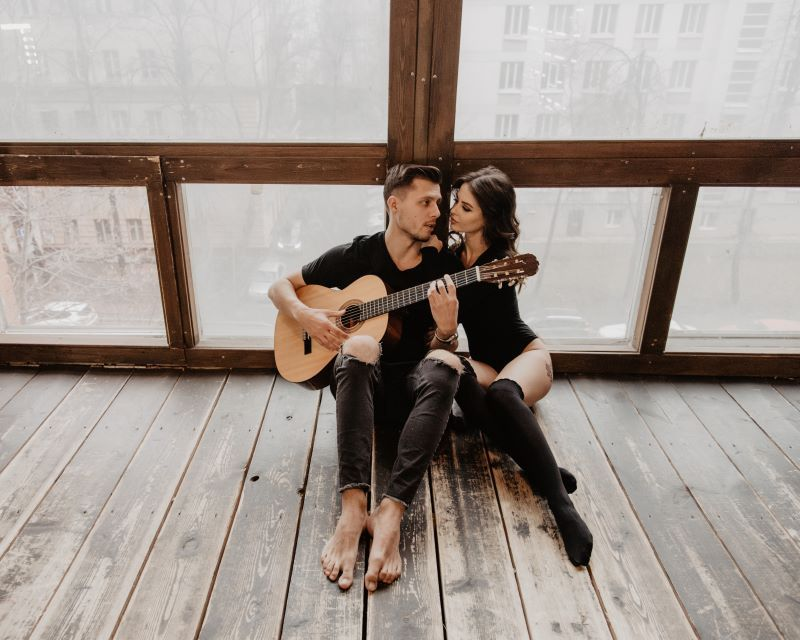 Man plays guitar to his girlfriend