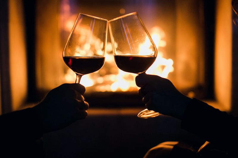Romantic dinner wine glasses and fire