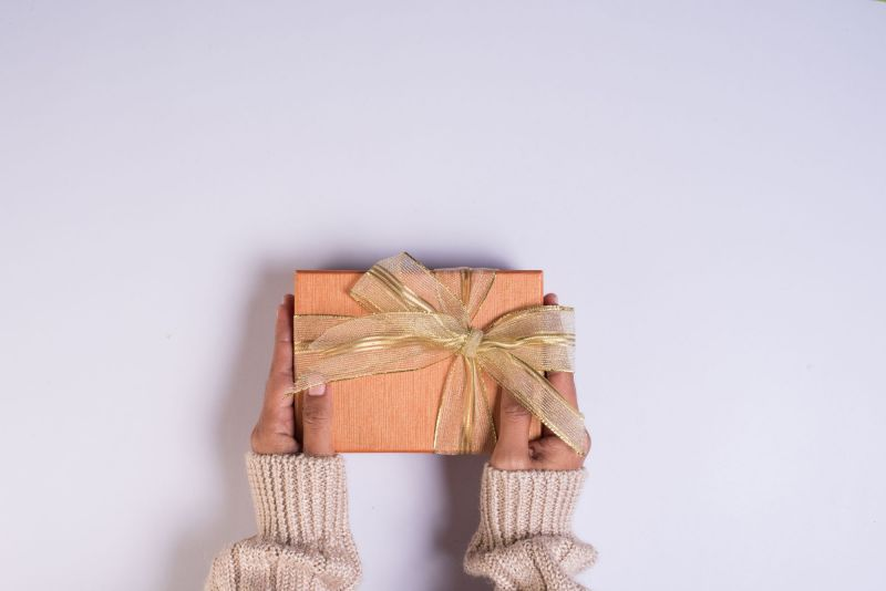 Top view of hands holding gift box