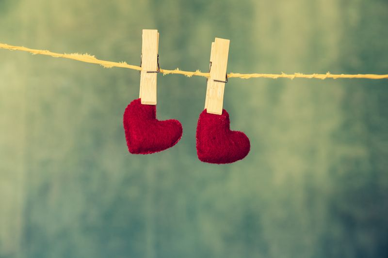 Two pegs holding hearts