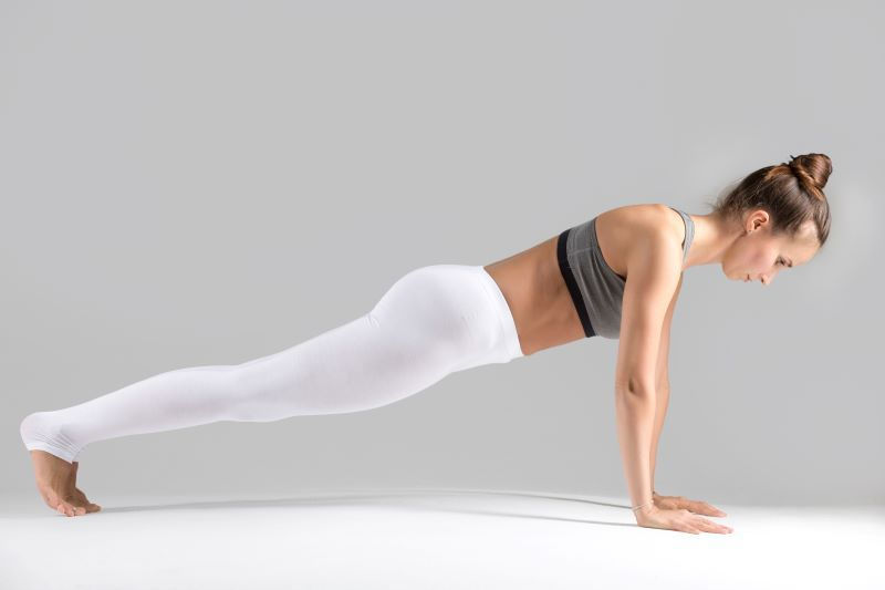 Woman exercising in plank pose