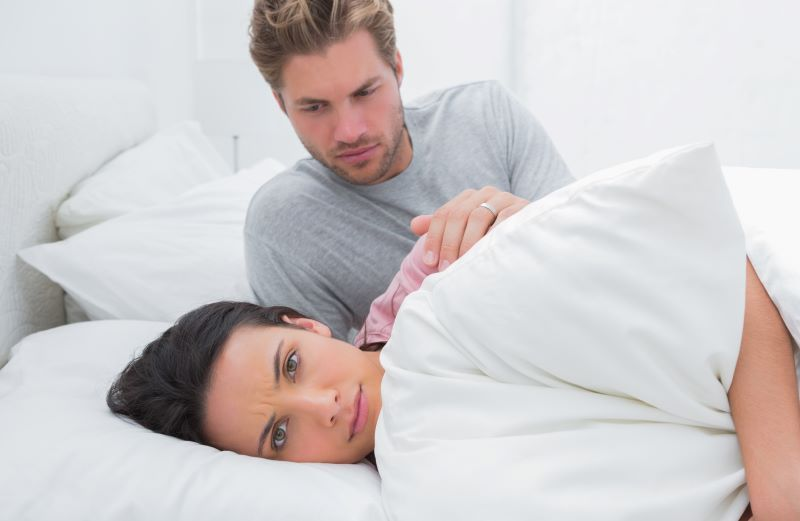 Woman ignoring her partner in bed