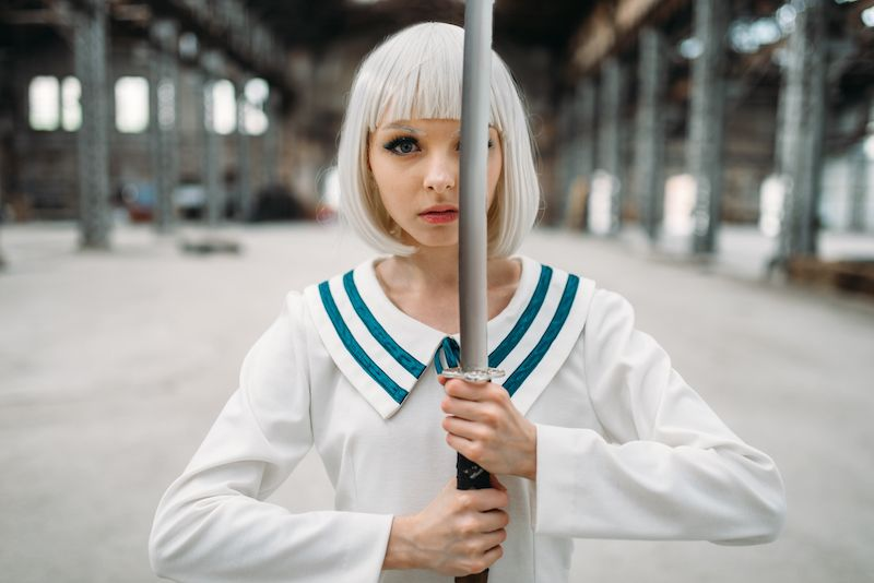 Woman in cosplay costume and wig