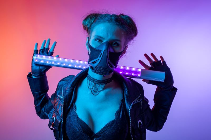 Woman in mask and neon background