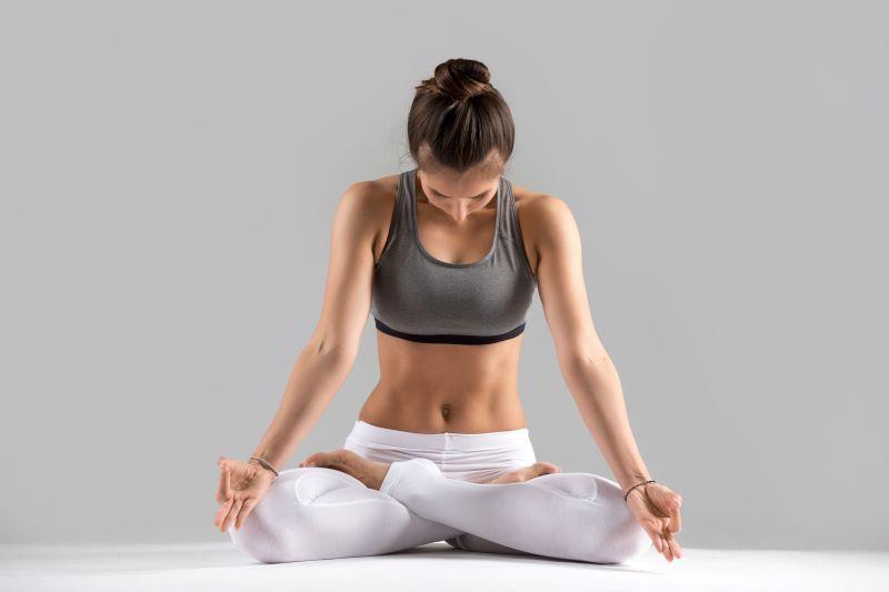 Woman in sitting yoga pose