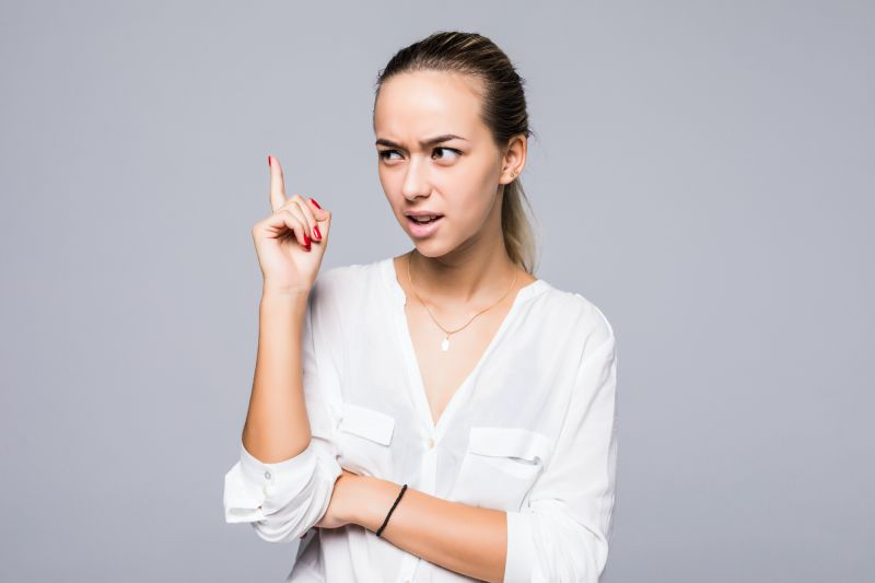 Woman pointing finger angrily