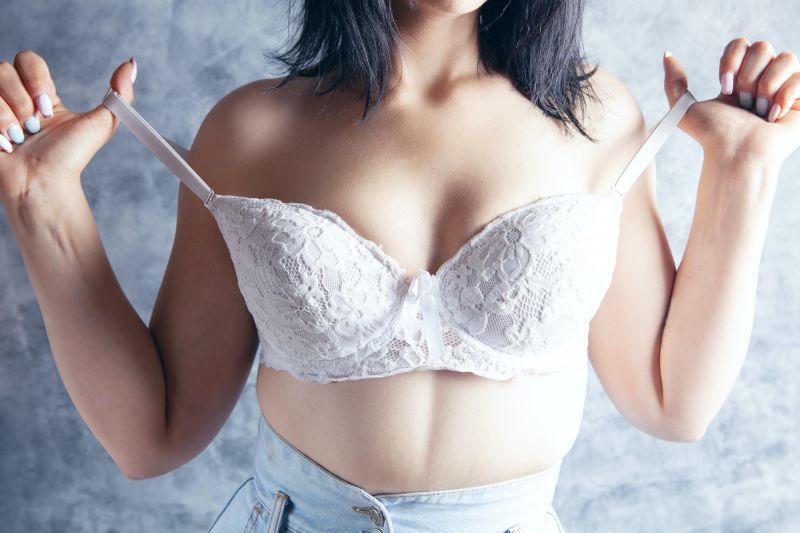 Woman removing bra