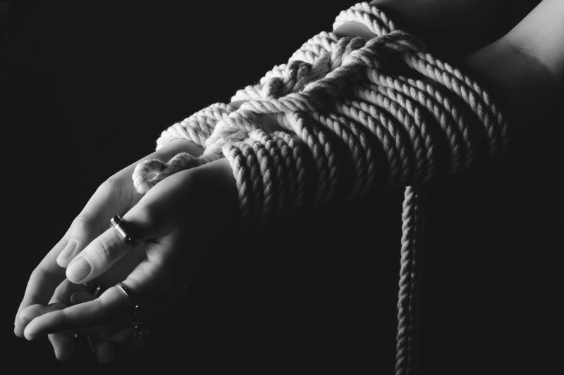 Woman with hands tied kinky