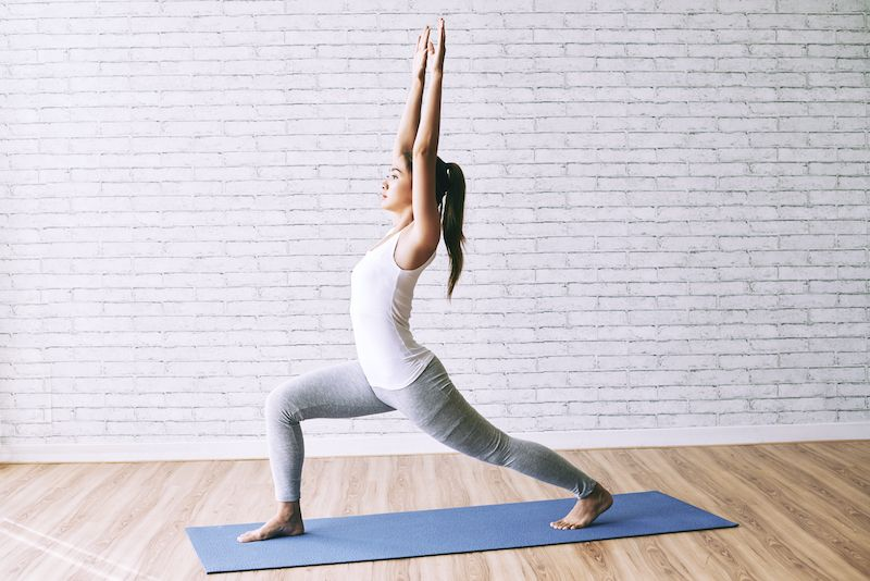 Woman yoga warrior pose
