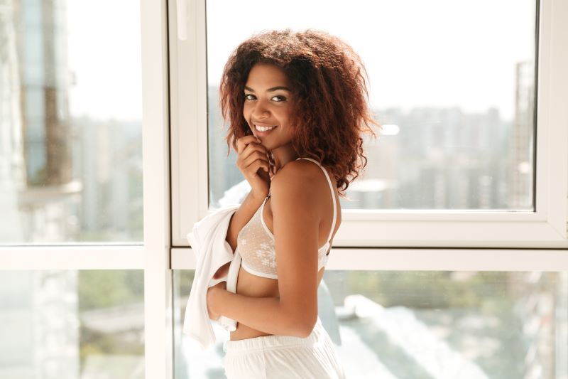 Young woman smiling by window