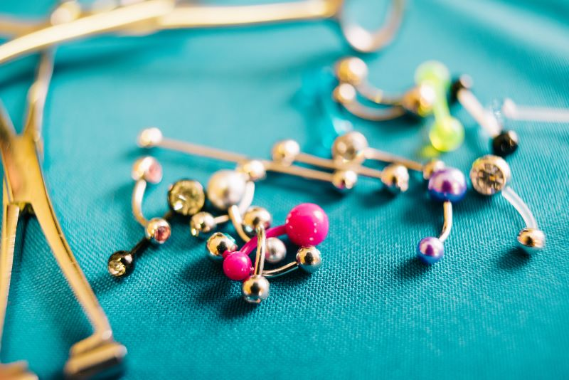 Piercing jewellery on turquoise table