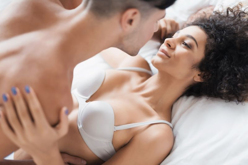 Romantic couple embracing in bed