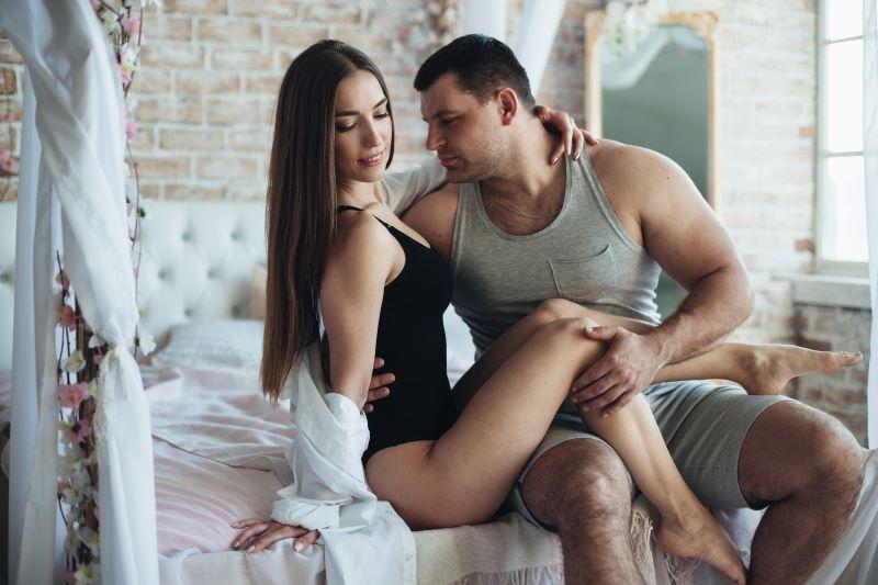 Seductive couple in bedroom