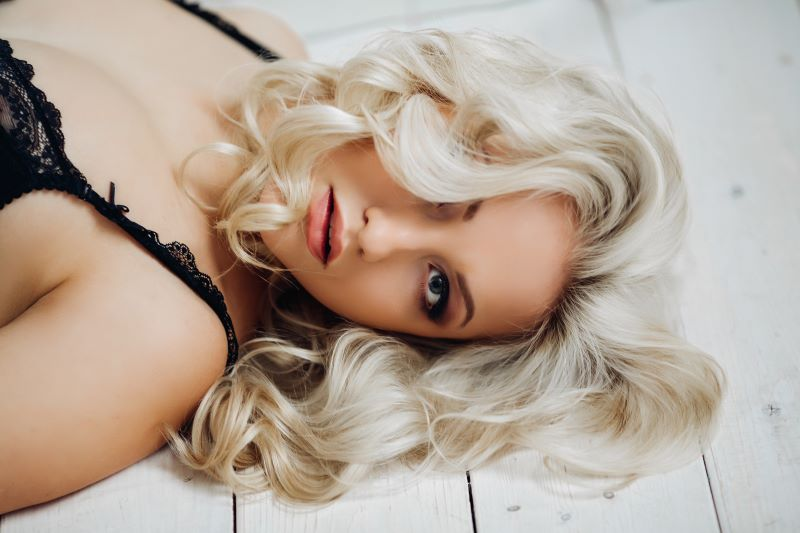 Sultry woman at home lying on the floor